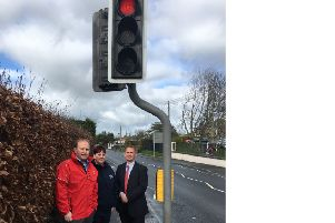 Alderman Wilson is pictured at the traffic lights on the Portadown Road with Principal of Tandragee Primary School David McCollam and the manager of Kids Academy Julieanne Guiney.