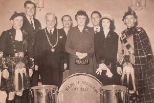 This mid 1950s photograph shows the platform party at the ceremony to amalgamate the Immanuel Old Boys and William Johnston Memorial Pipe Bands to form the Major Sinclair Memorial Pipe Band . 'L to R: PM Leslie McCourt (Immanuel OB), Brum Henderson, JA Faulkner (SPBA President), Bobby Graham, Mrs Maynard Sinclair, Mr and Mrs Herbie Harrison and PM John Finlay (Wm Johnston Memorial).
