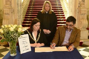 A book of condolence for those who lost their lives in the  attacks in New Zealand has been opened at Belfast City Hall.   The Lord Mayor Deirdre Hargey is pictured with Dr Muhammad Saleem Tareen, a member of the Executive Committee of Belfast Islamic Centre, and Karen Sethuraman, the Lord Mayor's Chaplain. Photo Arthur Allison/Pacemaker