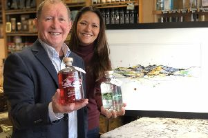 Noel Mills (Mourne Dew Distillery) and Kathryn Callaghan celebrate the launch of the new gin and and artwork at the Poachers Pocket Pantry in County Down, Lisbane.