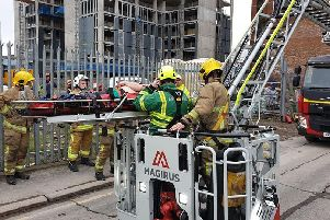 The casualty was rescued from the eighth floor of a building at Little Patrick Street/York Street. Pics by NIFRS East