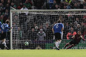 Estonia's Konstantin Vassiljev scores a penalty in 2011 against Northern Ireland at Windsor Park. Pic by PressEye Ltd.