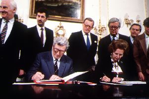 """Irish Premier Garret Fitzgerald and UK prime minister Margaret Thatcher sign the Anglo-Irish Agreement at Hillsborough Castle in 1985. """"Even after the agreement, the Irish state failed to extradite IRA murderers"""""""