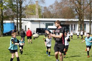 Ulster's Iain Henderson has returned to full fitness and was put through his paces earlier this week by pupils at Edenderry Primary in Portadown as part of a Kingspan Coaching Masterclass after the school won a competition through the News Letter and Portadown Times