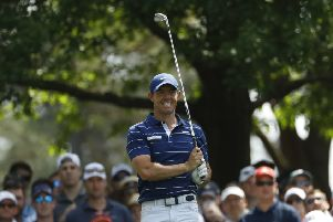 Rory McIlroy watches his drive on the fourth hole during the first round at the Masters.