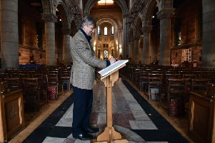 Signing the book of sympathy at Belfast Cathedral. Photo: Colm Lenaghan/Pacemaker Press