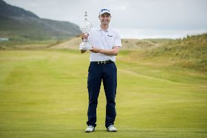 Russell Knox celebrates with the Dubai Duty Free Irish Open trophy on the 18th green at Ballyliffin Golf Club. Mandatory Credit �INPHO/Oisin Keniry