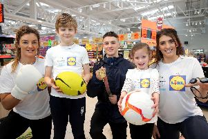 MMA gold medallist and Jiu Jitsu champion Leah McCourt, Leo Cullen, European gold gymnast Rhys McClenaghan, Ellie McGuigan and four-time Paralympic gold swimmer Bethany Firth pictured at the Lidl Connswater store to launch the programme
