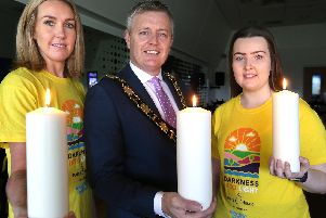 Mayor of Antrim and Newtownabbey, Councillor Paul Michael with Laura Campbell from Tesco Northcott and Chloe Erwin from Focus Group Antrim