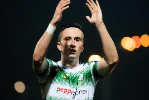 Shamrock Rovers midfielder, Aaron McEneff applauds the Hoops support at Brandywell.