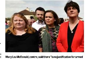 Mary Lou McDonald (centre) at a Creggan protest of Lyra McKee's murder