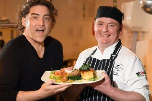 Singer songwriter Brian Kennedy and Kevin Osborne, head chef of Ballygally Castle Hotel, promote the cookery food demos which will be held as part of the Friends Goodwill Music Festival,