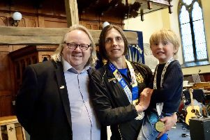 Elite runner Gladys Ganiel attended a church service staright after finishing the Belfast Marathon. Also pictured are Rev Steve Stockman of Fitzroy Presbyterian and her son Ronan.