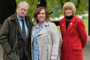 Actor Charlie Lawson with Yvonne Black (widow of murdered prison officer David Black) with Mary Moreland, who is the chairperson of The War Widows' Association. 'Pic Colm Lenaghan/Pacemaker