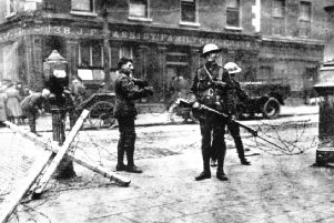 British troops man a road block outside Cassidy's grocery shop during the Easter Rising in Dublin, 1916.