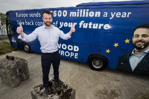 SDLP leader Colum Eastwood in front tof his election bus in Belfast. Photo: Liam McBurney/PA Wire
