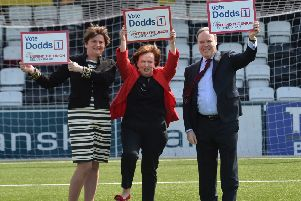 Arlene Foster , Diane Dodds and Nigel Dodds on the pitch at Seaview after yesterday's manifesto launch