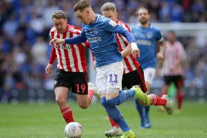 It's been a long year for Portsmouth striker, Ronan Curtis, pictured playing against Sunderland's Aiden McGeady in the Checkatrade Trophy Final.