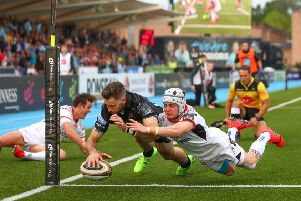 Former Ulster player, now Glasgow's Tommy Seymour scores a try despite Michael Lowry of Ulster