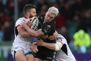 Glasgow Warrior's  Stuart Hogg is tackled by Ulster's Stuart McCloskey
