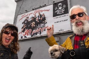 Garry Jackson with wife Mari with the anniversary billboard in Holywood