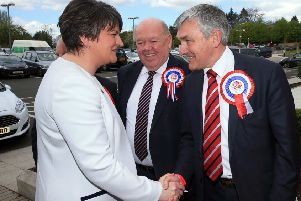 DUP MLA Thomas Buchanan (right) meeting party leader Arlene Foster at the 2016 Assembly election count
