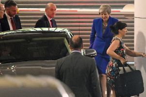 Prime Minister Theresa May leaves after making a speech in central London on her latest Brexit plans