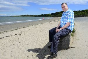 Andy Glenfield pictured at Ballyholme beach in his native north Co Down, which during the war years was used in the preparations for D-Day