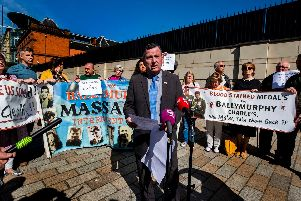 John Teggart of the Ballymurphy families reading a statement to the media on behalf of the families of those killed in shootings involving the parachuted regiment in Ballymurphy West Belfast 1971, during protest at the visit of the Prince of Wales, the regiment's commander-in-chief, to Belfast.