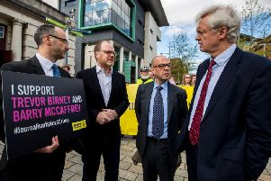 Head of Nations & Regions at Amnesty International UK Patrick Corrigan (left) stands with investigative journalists Trevor Birney (centre left) and Barry McCaffrey (centre right) as they speak with David Davis MP (right) outside Belfast High Court. Pic: Liam McBurney/PA Wire