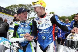 Peter Hickman congratulates Dean Harrison on his victory in the Senior TT.