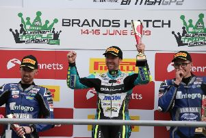 Alastair Seeley celebrates his victory in the British Supersport Sprint race with runner-up Jack Kennedy (left) and Brad Jones.