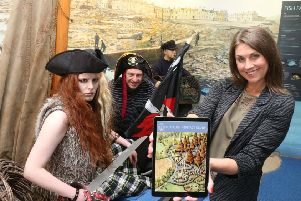 Sarah Travers launches the Portrush Heritage App with Portrush pirate Tavish Dhu and Chairman John McNally .