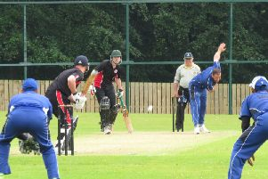 Neil Gill bowling for Muckamore