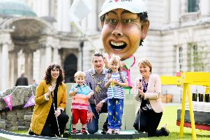 Lord Mayor John Finucane, Lesley-Ann ODonnell, Tourism NI project manager for The Open, and Liz Kerr, chair of Belfast One, get ready for The Great Belfast Tee Off at City Hall with siblings Eliza and Ronan Finnegan.