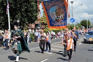 A piper led Larne LOL No 884 at a previous Twelfth celebration.  INNT 30-027-PSB