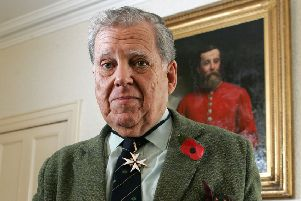 Col Robin Charley, veteran of the Korean War in the Royal Ulster Rifles, in front of a portrait of his Grandfather William Charley.'Picture by Brian Little