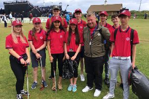Royal Portrush member Richard Beggs with some of the young people who are helping to keep the Dunluce Links litter-free during The Open