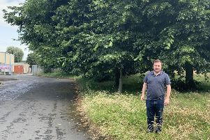 SDLP Cllr Thomas Larkham at an overgrown area close to a play school and youth club in Craigavon