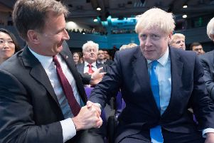 Candidate Jeremy Hunt (left) congratulates Boris Johnson after the result of the Conservative Party leadership election was announced in London