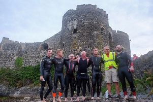 The jubilant swimmers with organiser Gary Davision at Carrickfergus Castle on completion of the challenge.
