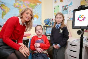 Charlie Craig with his mother, Cliodhna and sister, Nancy at the launch of the Children's Cancer Unit Charity's robotics project.  Photo by Matt Mackey / Press Eye