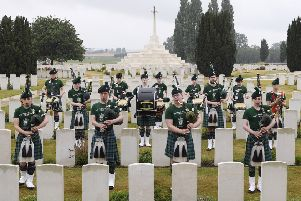 The Campbell College Pipes and Drums play at Tyne Cot, the largest Commonwealth War Graves Cemetery to commemorate 4 Old Campbellians who have no known grave: H Stevenson (OC 988), W Moore (OC 879), B Malone (OC 121) and W Campbell (OC 364)