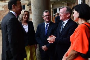 Leo Varadkar talks to Niall Gibbons of Tourism Ireland on his arrival at Hillsborough Castle on Wednesday August 7, while the local MP Sir Jeffrey Donaldson MP, centre, and others look on.'Pic Colm Lenaghan/Pacemaker