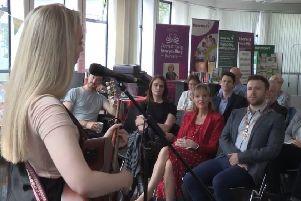 A screengrab of Saturday's event in Tullycarnet Library from a Sinn Fein video highlighting the visit of Martina Anderson (front row, centre)