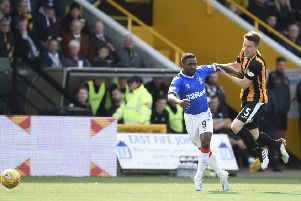 Rangers Jermain Defoe is held by East Fife's Ross Dunlop during the Betfred Cup second round match at The Bayview Stadium, Fife. PRESS ASSOCIATION Photo. Picture date: Sunday August 18, 2019. See PA story SOCCER Fife. Photo credit should read: Ian Rutherford/PA Wire. EDITORIAL USE ONLY