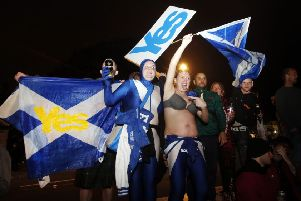 """Pro independence Scottish campaigners during the early phases of the independence referendum election count in 2014, which they in the end lost. """"The divisions in Scotland during the referendum placed often serious strains on relationships in families, in local communities and in work places"""" Photo: Danny Lawson/PA Wire"""