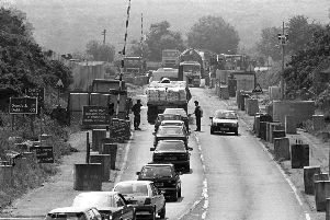 Vehicles queuing to be checked at the border at Newry in 1992. Photo: Pacemaker