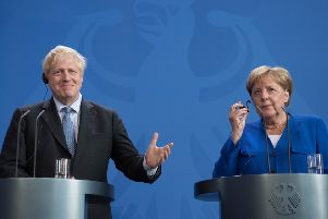 Prime Minister Boris Johnson holds a joint press conference with German Chancellor Angela Merkel in Berlin on Wednesday August 21, 2019. She seemed to imply there was a 30-day window for the UK to come up with solutions to the Irish border but later clarified the remark. Photo: Stefan Rousseau/PA Wire