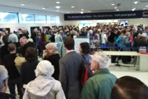 """A queue at Aldergrove airport security in May 2018. Taken with his permission from the twitter feed of Adrian Huston JP'@adrianhuston who wrote at the time:""""Chaos before security at #BFS #Aldergrove queues down the  stairs. @BBCgmu @BBCNewsNI some poor school group headed to Holland caught up"""""""